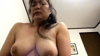 Mature Japanese lady with big hooters is a sucker for cock