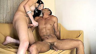 Muscled hunk strokes his long dick while a sexy shemale fucks his ass