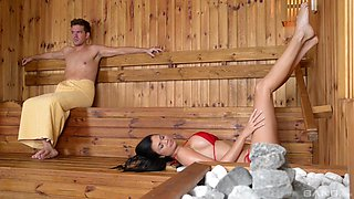 Busty brunette Jasmine Jae gets to play with a dick in the sauna