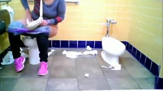 Chubby woman spied in public toilet peeing
