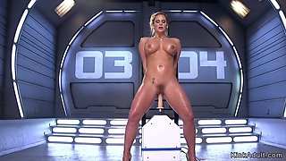 Busty milf standing and fucking machine