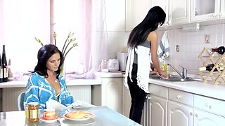 Mature and college girl in kitchen