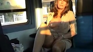 Sexy milf flashes her curves and touches herself in public