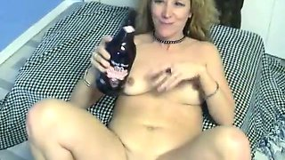 Well stacked blonde mommy masturbates with beer bottle