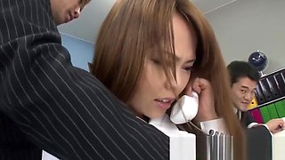 Asian secretary gets played with while she's on the phone