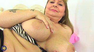 Buxom blonde mature amateur British MILF Alexa strips on a bed