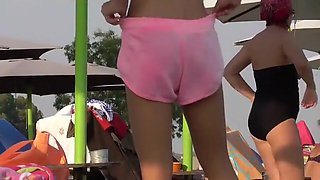 Teeny cameltoe seen by the pool
