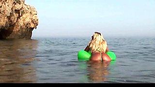 Blonde milf showing her ass in tiny bikini