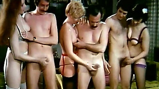 Three lewd couples have ardent group sex in retro video