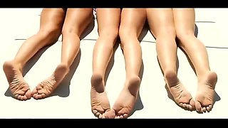 Three slender teens in sexy bikinis expose their lovely feet