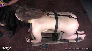 Hardcore spanking and humiliation for Nora Riley in extreme bondage