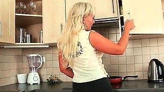Mom prepares herself for dessert in the kitchen
