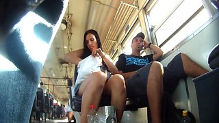 Upskirt video features a sexy young chick on a bus.