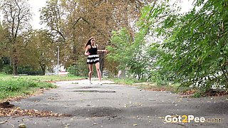 Hot brunette in splendid dress urinates in the woods