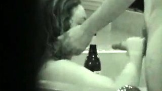 Cute chick sucking some cock in the tub on hidden cam
