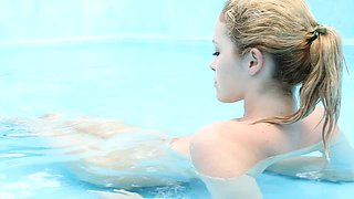 Delightful blonde babe Alissa White swims in the pool with no bikini on