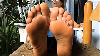 Naughty granny with glasses shows off her lovely feet