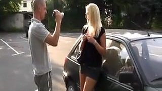 pretty german blonde slut sucks a guy on a parking