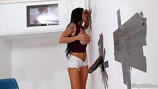 Black dick in the glory hole makes Melissa Lynn moan loudly