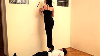 Blindfolded man gets dominated by a sexy babe in high heels