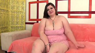 Cute and sexy plumper gets naked and fucks her plump pussy