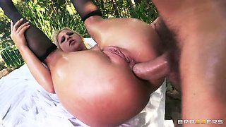 Oiled up blonde Kimmy Olsen gets her ass hammered in nature