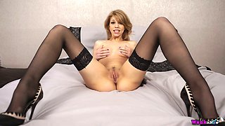 Leggy slender auburn lady Eva is interested in tickling clit and pussy