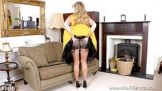 Sexy blonde finger fucks pussy in open girdle nylons