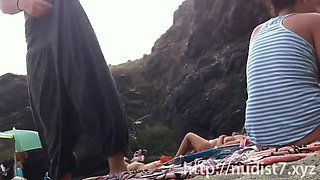 some sexy naked girls caught on the beach with a spy camera