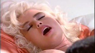Beautiful and hot blondie gives head and fucks on the bed