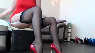 Slender brunette in stockings and high heels fucks herself