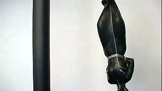 A bitch in latex overall gets suspended in BDSM scene