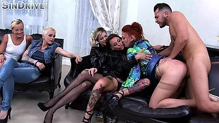 Nasty redhead woman fucked by a hunk in front of her friends