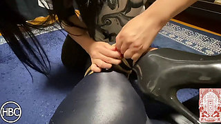 Tattoed Japanese in latex tied on the carpet