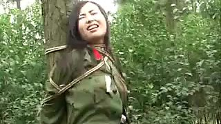 Cute Chinese army girl tied in the forest