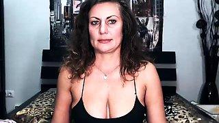 Stacked amateur cougar sensually masturbates on the webcam