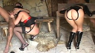Redhead mistress enjoying her female and male slaves