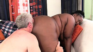 Ebony plumper gets her pussy fingered by a matured guy He