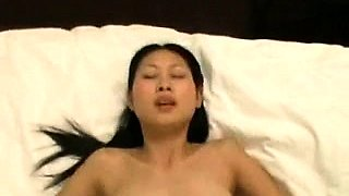 Adorable Thai babe takes a big shaft deep in her tight pussy
