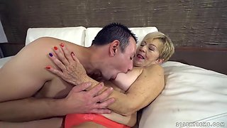 Mature blonde woman with short hair, Malya is cheating on her husband with a younger guy, Rob