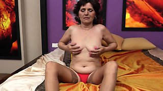 Unshaven granny having fun on the bed