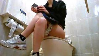 Asian women spied in toilet taking a pee